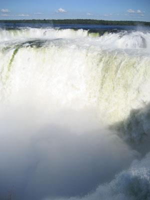 The massive amount of water pouring over La Garganta del Diablo in Iguazu Falls