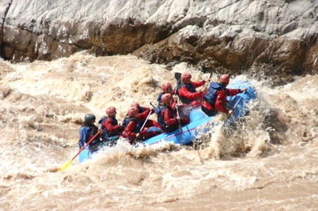 White (or should I say brown?) water rafting down some rapids in Mendoza.