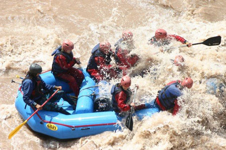 Getting slammed by some rapids on our Mendoza rafting trip with Ser O.
