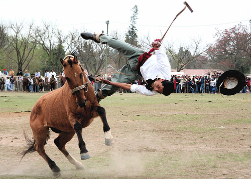 Argentinian Guacho taming a horse