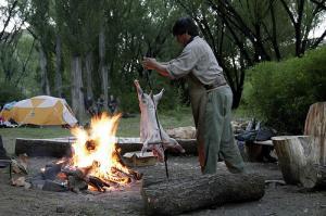 Gaucho making an asado